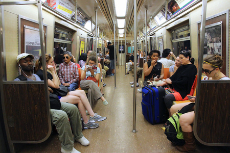 NEW YORK, USA - JULY 4, 2013: People ride Subway train in New York. With 1.67 billion annual rides, New York City Subway is the 7th busiest metro system in the world. 에디토리얼