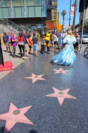 hollywood: LOS ANGELES, USA - APRIL 5, 2014: People visit famous Walk of Fame in Hollywood. Hollywood Walk of Fame features more than 2,500 stars with inscribed celebrity names. Editorial
