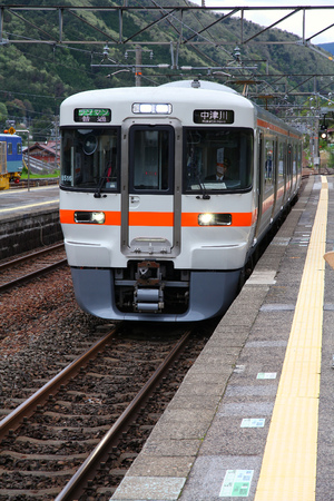 net income: NAGISO, JAPAN - MAY 2, 2012: Central Japan Railway Company electric train of 313 series arrives at Nagiso station. JR Central had 134 billion JPY in net income for 2011.