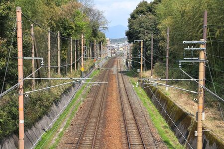 railway transportation: Kyoto, Japan - railroad tracks. Railway transportation infrastructure with electric lines. Stock Photo