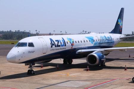 azul: CURITIBA, BRAZIL - OCTOBER 9, 2014: Azul Brazilian Airlines Embraer ERJ-190 at Curitiba Airport, Brazil. In 2013 Azul had 17 percent of domestic market share in terms of passengers per kilometre flown.