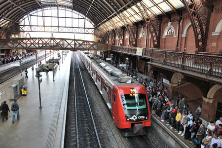 exists: SAO PAULO, BRAZIL - OCTOBER 6, 2014: People wait at Luz Railway Station in Sao Paulo. It is a major transportation hub for Sao Paulo and exists since 1867.