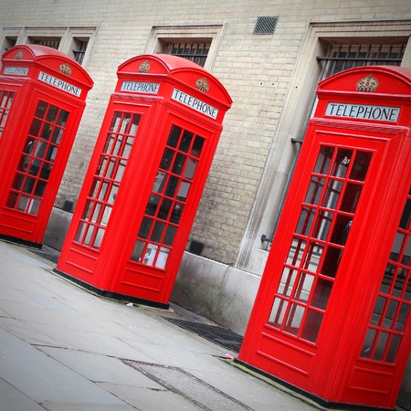 London, UK - red telephone booths of Broad Court, Covent Garden. Square composition.