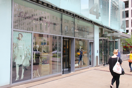 magnificent mile: CHICAGO, USA - JUNE 26, 2013: People walk by Salvatore Ferragamo store at Magnificent Mile in Chicago. The Magnificent Mile is one of most prestigious shopping districts in the United States.
