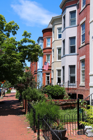 old street: Washington DC, capital city of the United States. Capitol Hill district with colorful townhouses.