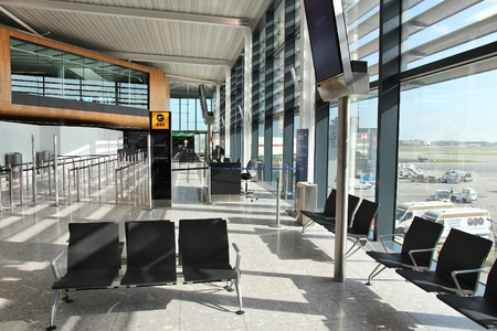 concourse: LONDON, UK - APRIL 16, 2014: Interior view of London Heathrow Airport in UK. Heathrow is the 3rd busiest airport in the world with 73.4 million passengers handled in 2014.