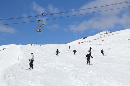 ski runs: VALLOIRE, FRANCE - MARCH 23, 2015: Skiers enjoy the snow in Galibier-Thabor station in France. The station is located in Valmeinier and Valloire and has 150km of ski runs. Editorial