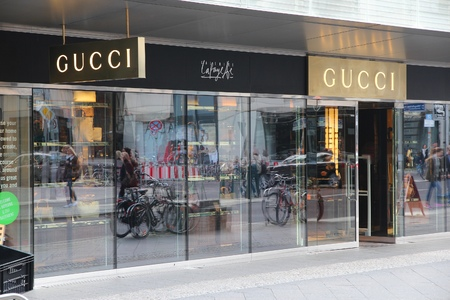 BERLIN, GERMANY - AUGUST 26, 2014: Gucci store windows in Berlin. Luxury brand Gucci exists since 1921 and was valued at 12.1 billion USD in 2013.