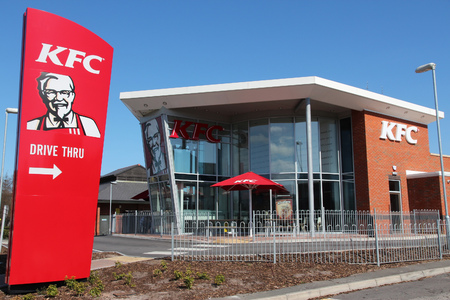 LIVERPOOL, UK - APRIL 20, 2013: Exterior view of KFC restaurant in Liverpool, UK. KFC is a popular worldwide fast food chain with 18,875 locations (2013).