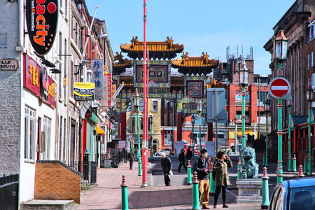 17 20: LIVERPOOL, UK - APRIL 20, 2013: People visit Chinatown in Liverpool, UK. It is estimated that 1.7 percent of Liverpools population is of Chinese descent.