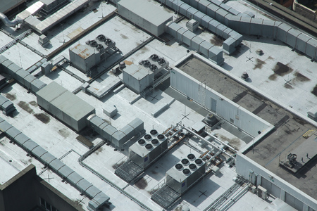 roof framework: Exhaust vents of industrial air conditioning and ventilation units. Building roof top in Liverpool, UK.