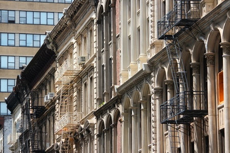 New York City, United States - old residential buildings in Soho district. Fire escape stairs. photo
