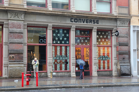converse: NEW YORK, USA - JUNE 7, 2013: People visit Converse store in Broadway, New York. Broadway is a famous 33 miles long street starting in Manhattan.