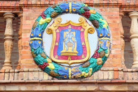 plaza of arms: Ciudad Real coat of arms in Plaza de Espana, Seville, Spain - old decorative ceramics. Stock Photo