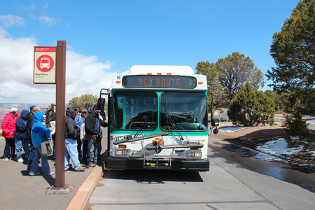 hopi: GRAND CANYON, USA - APRIL 3, 2014: People ride the Hermit Road shuttle bus in Grand Canyon National Park in Arizona. 4.56 million tourists visited Grand Canyon in 2013. Editorial