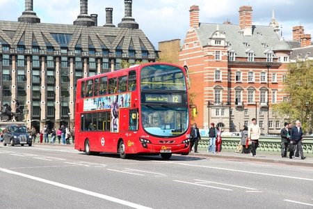 lb: LONDON, UK - MAY 16, 2012: People ride London Bus in London. As of 2012, LB serves 19,000 bus stops with a fleet of 8000 buses. On a weekday 6 million rides are served.