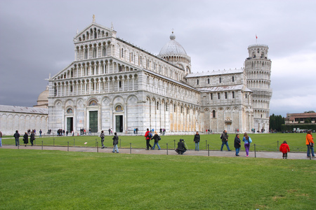 piazza dei miracoli: PISA, ITALY - OCTOBER 21, 2009: People visit the cathedral in Pisa, Italy. Duomo square is a UNESCO World Heritage Site and Italy is the 5th most visited country in the world (46 million in 2012).