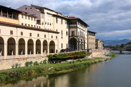 river arno: Florence, Italy - Old Town reflection in River Arno. Uffizi Gallery.