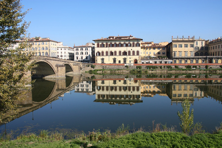 arno: Florence, Italy - Old Town reflection in River Arno.