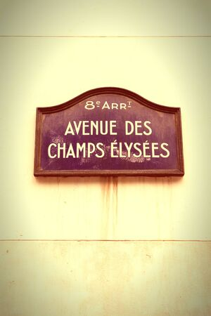 Paris, France - Champs Elysees sign. Cross processed colors style - filtered tone retro image.