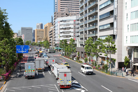 capita: TOKYO, JAPAN - MAY 11, 2012: People drive cars in Tokyo. With 591 vehicles per capita, Japan is a country with one of highest car ownership rates.