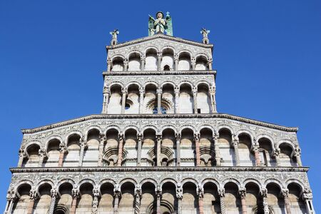 archangel: Lucca, Italy - medieval town of Tuscany. San Michele in Foro - Catholic church basilica dedicated to Archangel Michael.