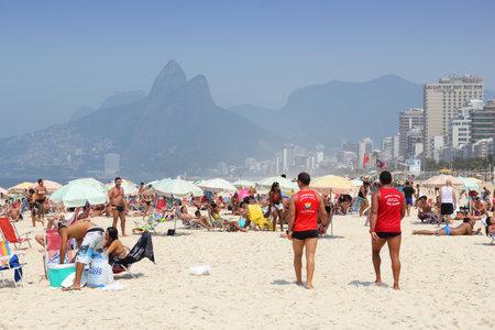 rio de janeiro: RIO DE JANEIRO, BRAZIL - OCTOBER 19, 2014: People visit Ipanema beach in Rio de Janeiro. In 2013 1.6 million international tourists visited Rio.