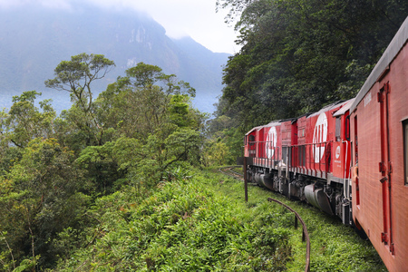 viaducts: SERRA VERDE, BRAZIL - OCTOBER 8, 2014: People ride Serra Verde Express, a jungle train in Brazil. The famous railway line was constructed in 1880s and has 13 tunnels and 30 viaducts. Editorial