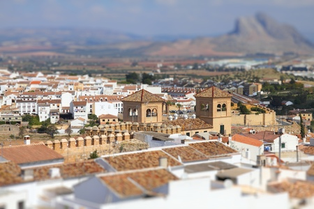 tilt view: Antequera in Andalusia region of Spain. Aerial view of typical Spanish town. Tilt shift style focus with blurred background.