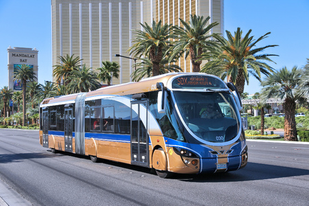las vegas casino: LAS VEGAS, USA - APRIL 14, 2014: People ride SDX bus in Las Vegas. SDX is operated by Wright StreetCar articulated hybrid bus manufactured by Wrightbus and Volvo.