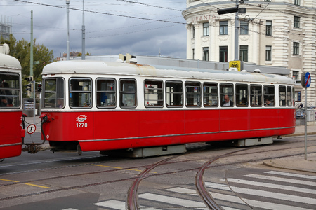 largest: VIENNA, AUSTRIA - SEPTEMBER 9, 2011: People ride a tram in Vienna. With 172km total length, Vienna Tram network is among largest in the world. In 2009 186.9m passengers used Vienna trams. Editorial