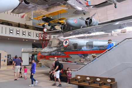 museum visit: WASHINGTON, DC - JUNE 13, 2013: People visit Smithsonian National Air and Space Museum in Washington. It holds the largest collection of historic aircraft and spacecraft in the world. Editorial