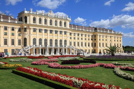 schoenbrunn: VIENNA, AUSTRIA - SEPTEMBER 6, 2011: People visit Schoenbrunn Gardens in Vienna. As of 2008, Vienna was the 20th most visited city worldwide (by international visitors). Editorial