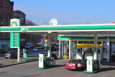 bp: SIEMIANOWICE SLASKIE, POLAND - MARCH 9, 2015: People fill their cars at BP gas station in Siemianowice Slaskie. BP had USD 4.003 billion profit in 2014.