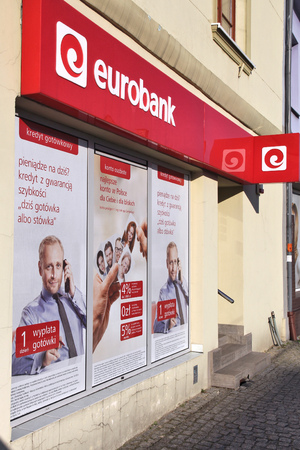 sg: CZELADZ, POLAND - MARCH 9, 2015: Eurobank branch in Czeladz, Poland. Eurobank is part of Societe Generale. SG is 6th largest bank group in Europe by assets (1,705.9 billion USD, 2013). Editorial