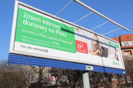 gsm: SIEMIANOWICE SLASKIE, POLAND - MARCH 9, 2015: Plus GSM billboard of Stroeer media in Siemianowice Slaskie. Plus mobile phone operator has 13.8 million customers (2013).