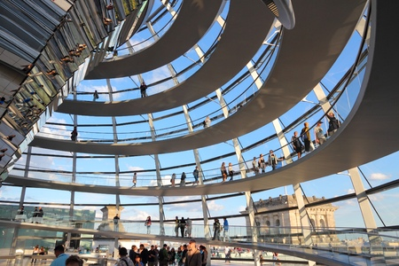 dome building: BERLIN, GERMANY - AUGUST 27, 2014: People visit Reichstag building dome in Berlin. The dome was completed in 1999. It was designed by architect Norman Foster.
