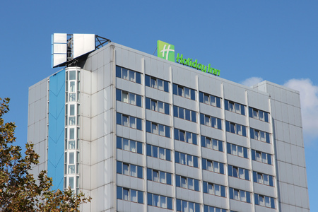 intercontinental: BERLIN, GERMANY - AUGUST 27, 2014: Holiday Inn hotel in Berlin. Holiday Inn is a brand of hotels with 3,400 locations (2015), part of Intercontinental Hotels Group. Editorial