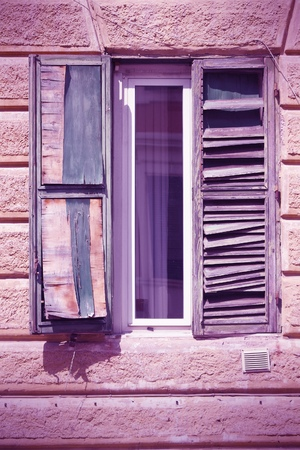 architectural feature: Rome, Italy - architectural feature in Trastevere district, old window. Cross processed color style - retro image filtered tone.