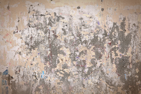 grungy: Grungy wall with peeling paint. Grungy background texture.
