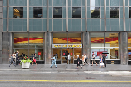 NEW YORK, USA - JULY 1, 2013: People walk by Wells Fargo Bank branch on in New York. Wells Fargo was the 23rd largest company in the United States in 2011 (by revenues).