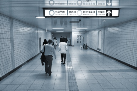 billion: TOKYO, JAPAN - APRIL 13, 2012: People enter Toei Metro in Tokyo. With more than 3.1 billion annual passenger rides, Tokyo subway system is the busiest worldwide.