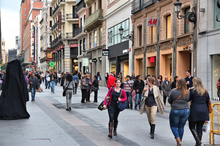 visitors area: MADRID, SPAIN - OCTOBER 24, 2012: People shop downtown in Madrid. Madrid is a popular tourism destinations with 3.9 million estimated annual visitors (official data).