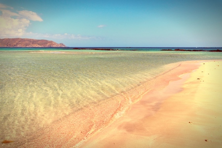 Landscape of Crete island in Greece. Pink sand beach of famous Elafonisi (or Elafonissi). Vintage style - filtered colors. photo