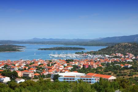 murter: Murter island, Croatia - Mediterranean coast landscape in Dalmatia. Adriatic Sea view - town Murter.