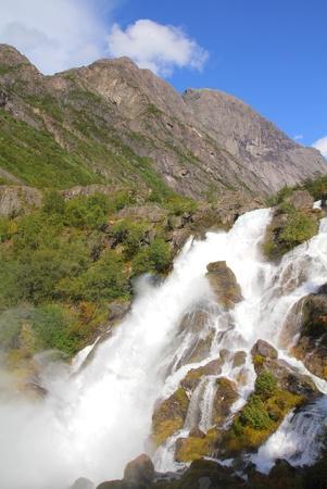 jostedalsbreen: Norway nature - waterfall landscape. Jostedalsbreen National Park - Briksdalen Valley.