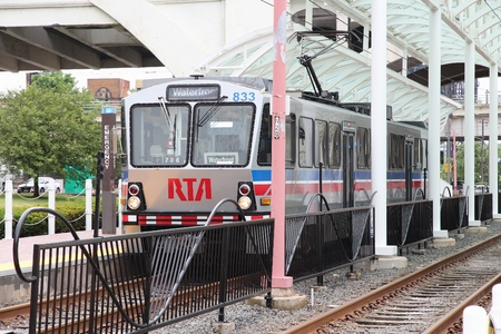 rta: CLEVELAND, USA - JUNE 29, 2013: People ride RTA Rapid Transit light rail in Cleveland. Greater Cleveland Regional Transit Authority (RTA) exists since 1975 and operates 37 miles of rail.