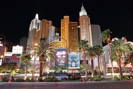 LAS VEGAS, USA - APRIL 13, 2014: People visit the famous Strip in Las Vegas. 15 of 25 largest hotels in the world are located at the strip with more than 60 thousand rooms.