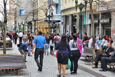 inhabitants: CURITIBA, BRAZIL - OCTOBER 7, 2014: People shop in pedestrian zone of Curitiba, Brazil. Curitiba is the 8th most populous city of Brazil with 1.76 million inhabitants.