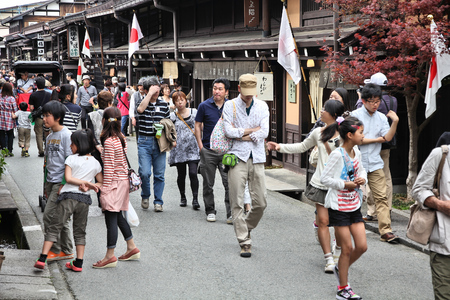 25 29: TAKAYAMA, JAPAN - APRIL 29, 2012: People visit the Old Town in Takayama, Japan. Takayama is among top 25 tourism destinations in Japan according to Japan-Guide.com.